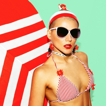 strip club: Pretty Blonde Beach Style. Fashionable swimsuit and accessories. Club party vibes