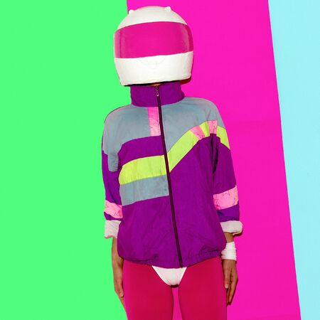 motobike: Model in a motorcycle helmet. Minimal fashion art era rave
