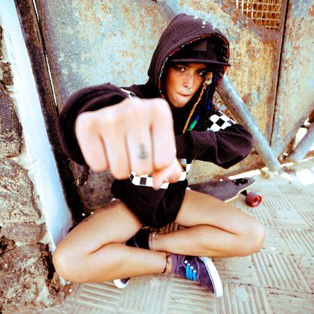Young girl hip hop style. Urban street fashion. Skateboard life Stock Photo