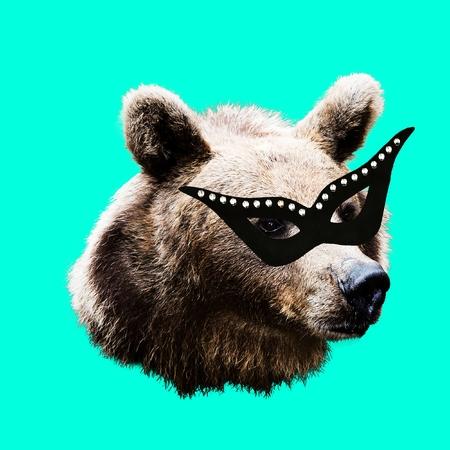 Fashion collage minimal. Photo manipulation. Masquerade Bear. Funny art. Stock Photo