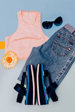 designer: Stylish urban clothing. Sandals platform. Jeans and top. Summer outfit Stock Photo