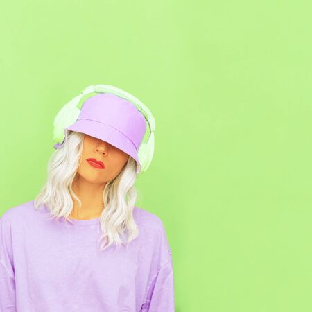 Hipster Dj Girl in stylish headphones and bucket hats. Minimal monochrome colours design trends Banque d'images