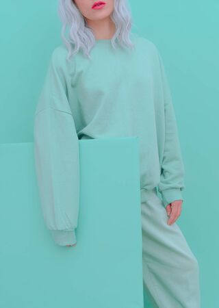 Girl in Fresh Mint Fashion Look. Minimal aesthetic monochrome design. Aqua menthe color trend Banco de Imagens