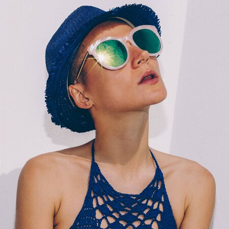 Sensual tanned hipster model. Stylish Boho outfit trend sunglasses and hat. My Havana