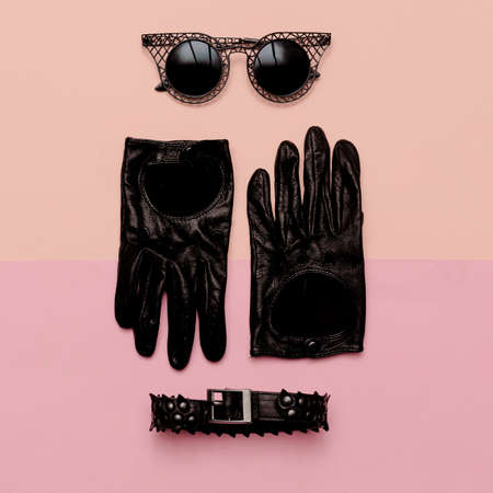 Clothes top view Womens Accessories Gloves, sunglasses, choker. Swagger style fashion Foto de archivo