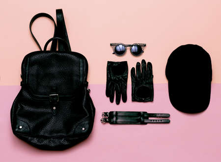 clothes top view Black Womens Accessories Gloves, sunglasses, bracelet. Cap. Swag fashion Stylish backpack Stock Photo