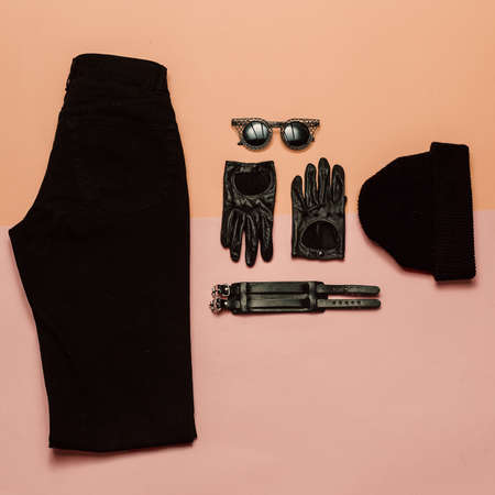 Stylish outfit View from above. Black clothes and accessories, Beanie Gloves, jeans. Urban Stylish Fashion