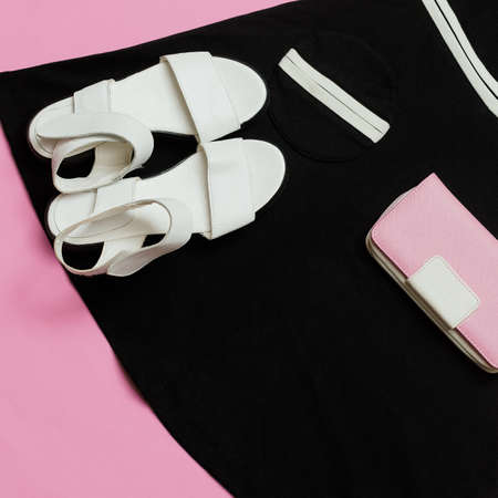 Vintage Boutique for Ladies. Retro Summer. Sandals Outfit and Black dress. Clutch. Minimal design Stockfoto