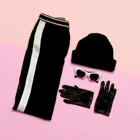 Black Fashion clothing set. Accessories For Women. Beanie. Gloves. Urban sport casual style Stockfoto