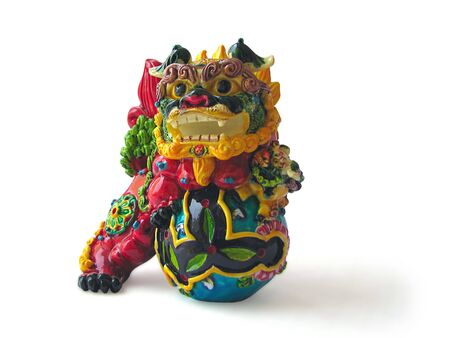 colorful oriental chinese dragon feng statue isolated on white photo