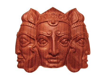 indian god: The wooden mask of indian god Trimurti isolated on white