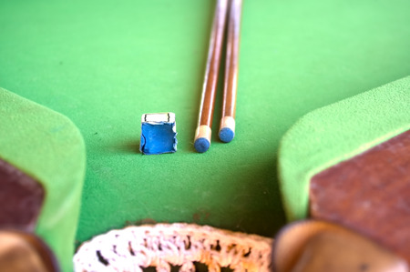 cue sticks: Billiard cue and chalk on table Stock Photo
