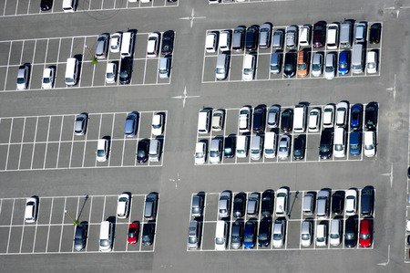a lot  of: Aerial view of a parking lot with many cars Stock Photo
