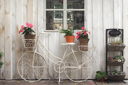 antique wood: vintage bicycle on vintage white wooden house wall