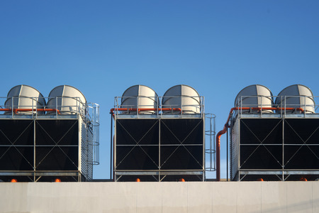 outside machines: Industrial air conditioner on the roof against blue sky Stock Photo