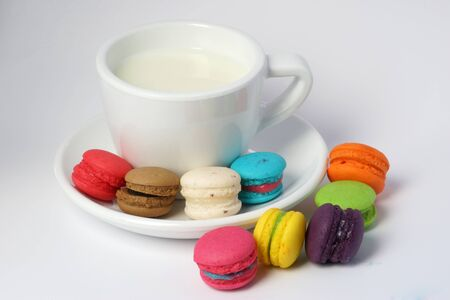 macarons: Colorful macarons and milk cup on white Stock Photo