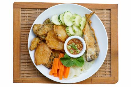 Thai cuisine-Nam Prik Gapi or Shrimp Paste Chili Dip serves with fried mackere fish  and various vegetables