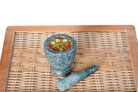Thai cuisine-Nam Prik Gapi or Shrimp Paste Chili Dip in mortar and  pestle on wooden background