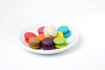 Colorful macarons on wooden background
