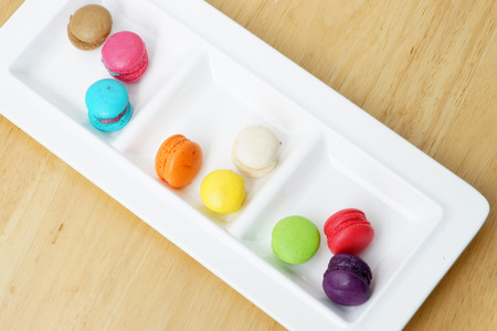 macarons: Colorful macarons on wooden background