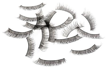 false eyelashes isolated on white Foto de archivo