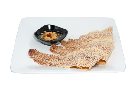 Grilled  dried  squid  with sweet and sour sauce isolated on white Foto de archivo