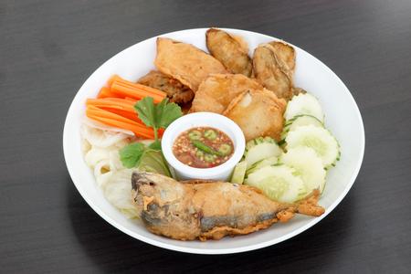 Thai cuisineNam Prik Gapi or Shrimp Paste Chili Dip serves with fried mackere fish  and various vegetables
