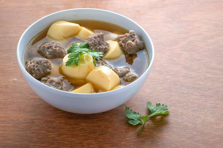 Thai Cuisine;Minced pork and soya bean curd soup on wood background Foto de archivo