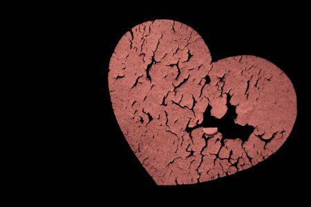 Broken heart against a dark background Imagens