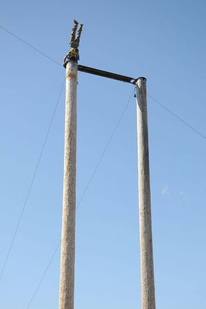 reverse: Man doing headstand on 60-foot pole Stock Photo