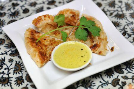 doughy: Roti canai (Malaysian flatbread) Stock Photo