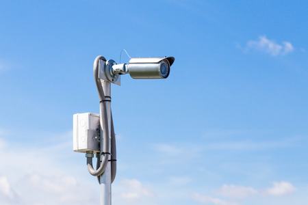 city surveillance: outdoor security camera with housing Stock Photo