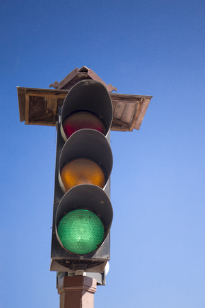 lit image: image of traffic light the red light is lit. symbolic for holding. Stock Photo