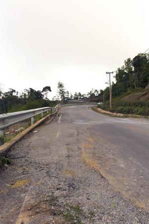 quake: Collapsed Asphalt Road Cracked and Broken.