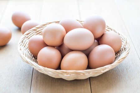 organically: closeup eggs on wooden table