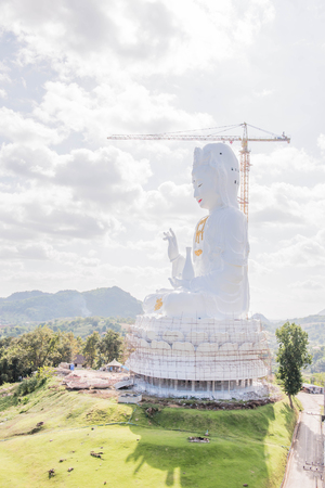 goddess of mercy: Guan Yin is the Goddess of Mercy is underconstruction in nature background