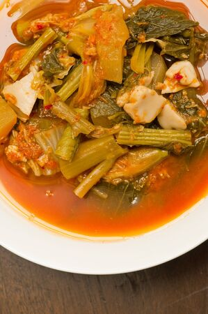 sour soup  made of tamarind paste tofu and vegetable photo