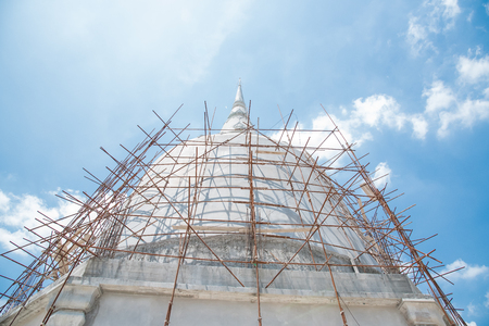 hollow wall: Iron scaffolding for Thai pagoda construction Stock Photo