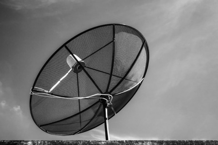 Satellite dish on roof with beautiful sky