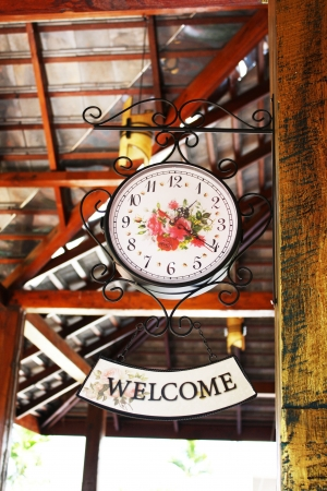 welcom: the clock and welcome tag of house wood