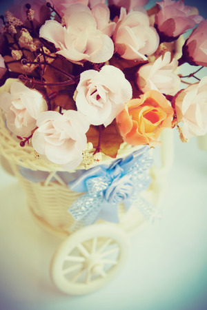 Bunch of flowers in basket. photo