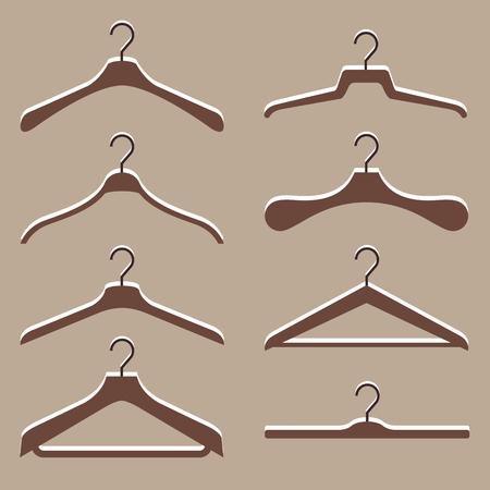 Vector reeks leuke hanger kleren op geïsoleerde bruine achtergrond