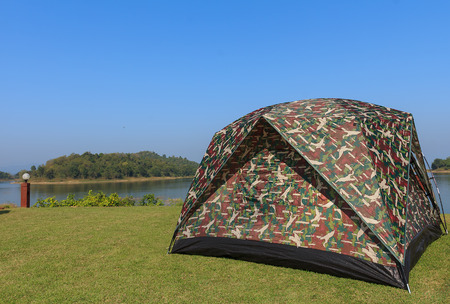 camping pitch: camping tent on a shore in a morning light