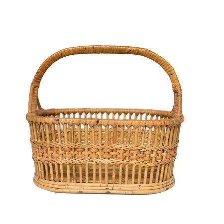 Empty wicker basket isolated on white background photo