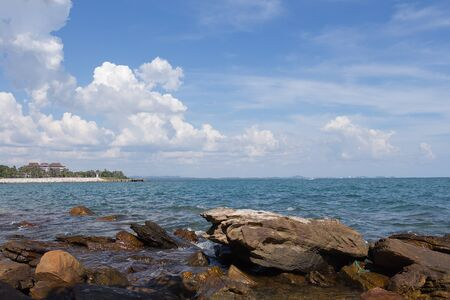 blue widescreen widescreen: Stone in sea with blue sky Stock Photo