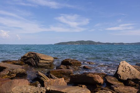 Beautiful landscape blue sky sea and waves on beach near the rocks during summer at Rayong province, Thailand,