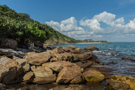 blue widescreen widescreen: Beautiful landscape blue sky sea and waves on beach near the rocks during summer at Rayong province, Thailand,