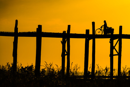 longest: U bein bridge, Taungthaman lake, Amarapura, Burma. It is the oldest and longest teak wooden bridge in the world Stock Photo