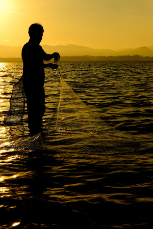 entrapment: Fisherman of Bangpra Lake in action when fishing, Thailand