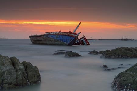 beached: Twilight.Landscape shipwreck - fishing boat asia Thailand Stock Photo